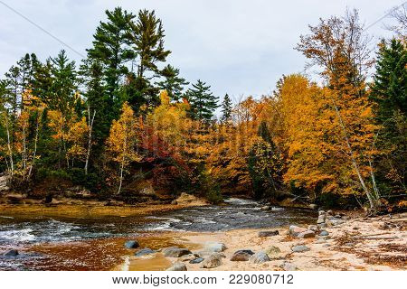 River in forest in Pictured Rocks National Lakeshore,  Munising, MI, USA. Autumn forest on the backghround poster