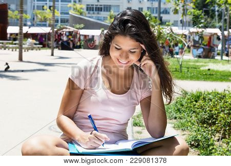 Successful Caucasian Female Student Learning Outdoors In Summer In City