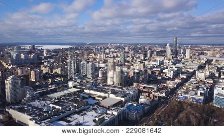 Amazing Cityview. Aerial View On City With Buildings And Blue Sky Background. City Aerial View. View