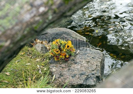 Bouquet Of Flowers Lies On The Stones Near The Water, Bride Bouquet, Sunflowers, Autumn Bouquet, Wed