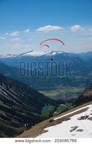 View From Nebelhorn Mountain To Tourist Destination Oberstdorf, Bavarian Spring Landscape With Float