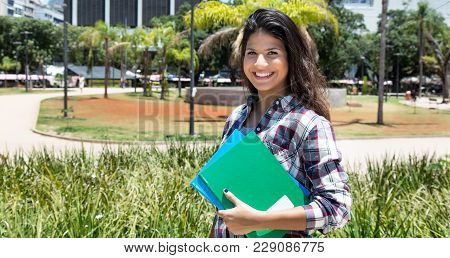 Beautiful Caucasian Female Student Laughing At Camera Outdoors In The Summer On Campus Of University