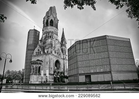 The Protestant Kaiser William Memorial Church In The Centre Of The Breitscheidplatz. The Original Ch