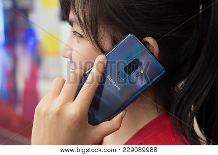 Chiang Mai , Thailand - Mar 1, 2018: A Woman Talking With Smartphone Samsung Galaxy S9 Plus With Cor