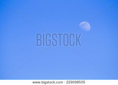 The Moon In The Daytime Sky Blue