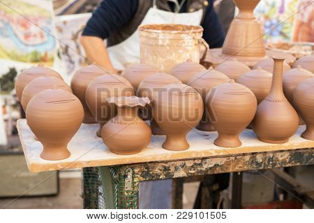 Pottery. Craft, handicraft. Clay pots are sold on the street.