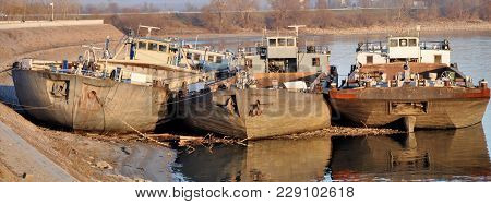 Three Old Rusty Abandoned Barges Abandoned On The River