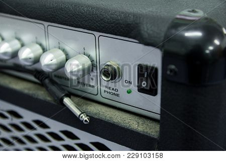 Close Up Guitar Amplifier With Black Cable Audio Jack