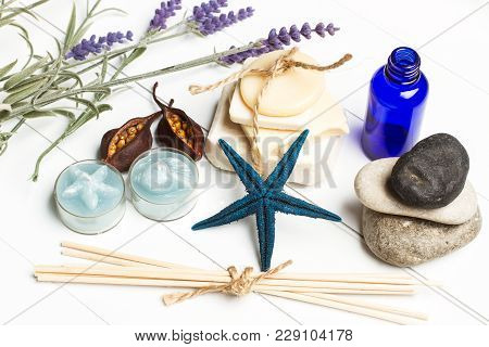 Body Care Soaps And Candles For Aromatherapy On A White Woooden Table
