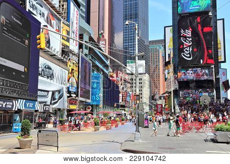 New York, Usa - July 7, 2013: People Visit Times Square In New York. The Square At Junction Of Broad