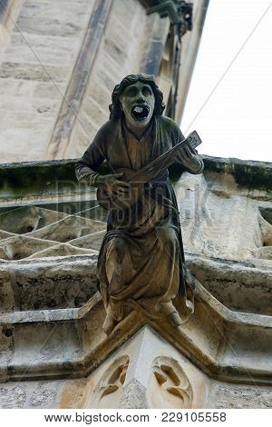 Gargoyle On The Saint Barbara Cathedral In Town Of Kutna Hora, Bohemia