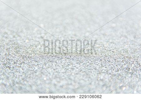 Sliver Glitter Defocused Texture Background. Silver Sparkle Wallpaper For Christmas