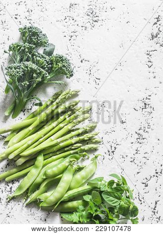 Fresh Broccoli Cabbage, Asparagus, Green Peas, Herbs On Light Background, Top View. Vegetables Veget