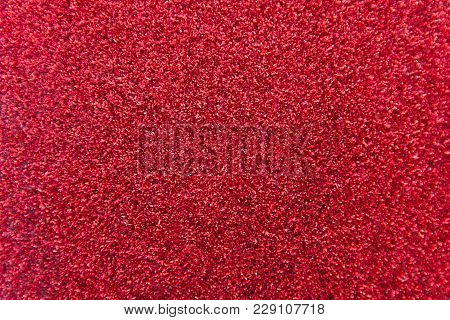 Red Glitter Texture Background. Red Christmas Abstract Background