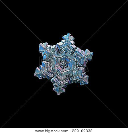 Snowflake Isolated On Black Background. Macro Photo Of Real Snow Crystal: Elegant Star Plate With Gl