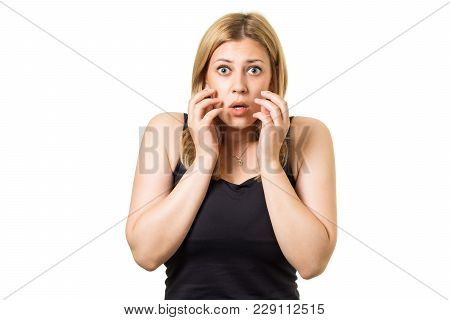Attractive Portrait Of Amazed Cute Young European Blonde With Hands Near Her Face