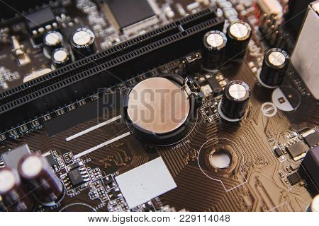 Lithium Battery Coin On Computer Motherboard. Circuit Board