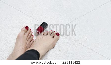Closeup Of Beautiful Female Feet With Nail Varnish In Red Colour With Copy Space, Relaxing Of Women