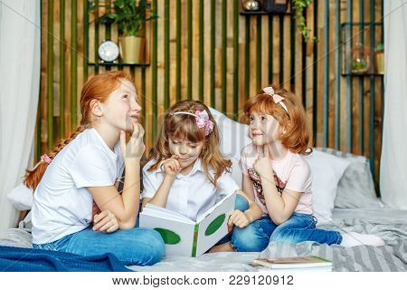 Three Children Think About What Is Written In The Book. The Concept Of Lifestyle, Childhood, Educati