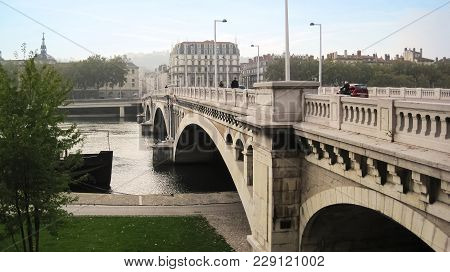 The Ancient Bridge In City Lyon Made From Stone Connecting Two Parts Of City At Cloudy Day|white|aut