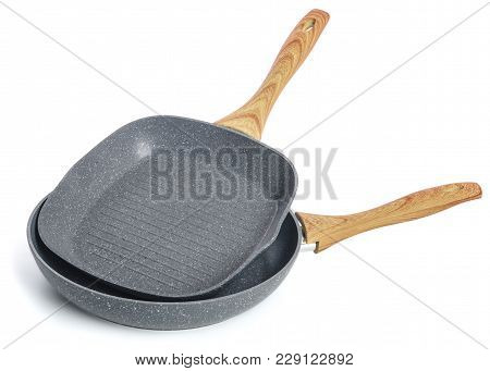 Two Cast-iron Frying Pans With A Wooden Handle Without A Lid, On A White Background.