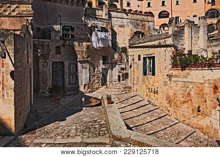 Matera, Basilicata, Italy: Picturesque Corner And Ancient Houses In The Old Town Called Sassi Di Mat