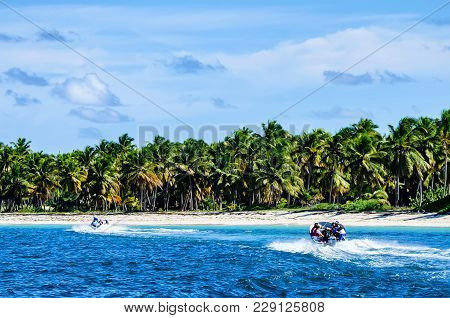 Santo Domingo, Dominican Republic - October 29, 2015: Tourists In Motor Boats In Ocean In Dominicana
