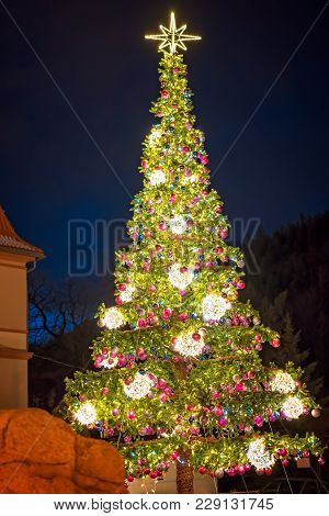 Huge Christmas Tree With Lights And Decorations Outside On A Street In Karpacz Resort Town, Poland