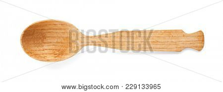 Wooden spoon on white background. Handcrafted cooking utensils