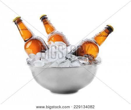 Bowl with bottles of beer in ice on white background