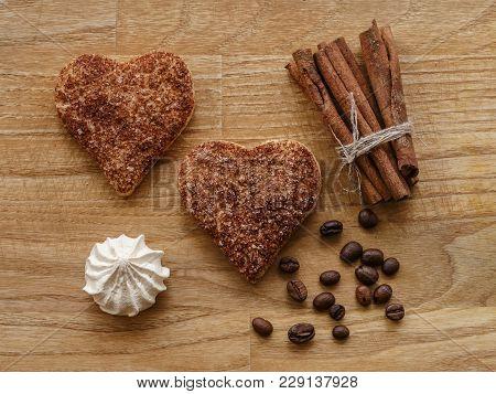 Meringue, Cinnamon Hearts Cookies And Sticks Wood Texture