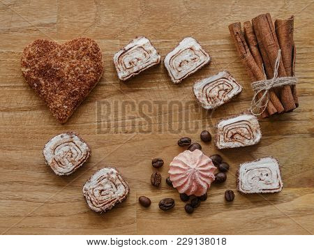 Meringue, Cinnamon Hearts Cookies And Sticks And Turkish Delight Wood Texture