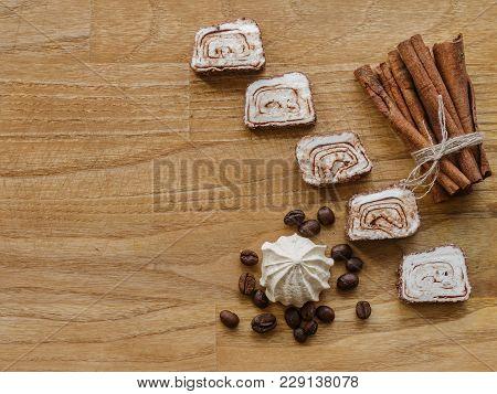 Meringue And Cinnamon Sticks And Turkish Delight Wood Texture