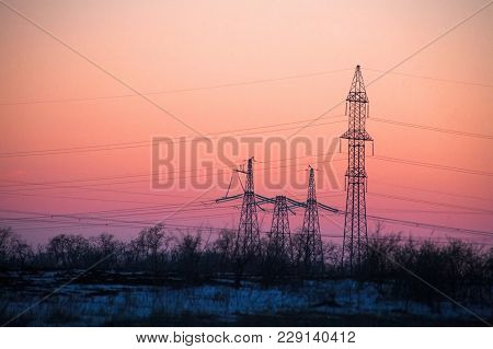 Electricity Pylon - Power Lines Overhead Power Line Transmission Tower Of The Sunset.