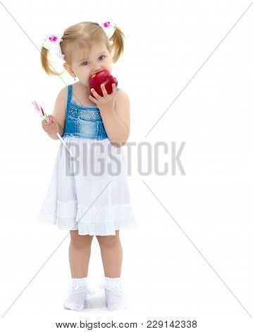 Little Girl With An Apple. Concept Of Healthy Eating, Harvesting. Isolated On White Background.
