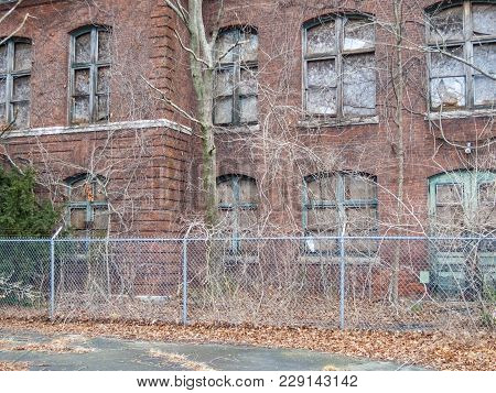 Old Atlas Tack Factory Now Overgrown And Dilapidated In Fairhaven, Massachusetts