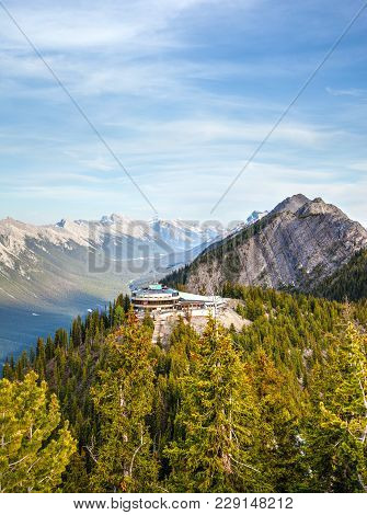 Aerial View Of Sulphur Mountain Observation Deck With Banff Mountain Range In The Background. The Lo