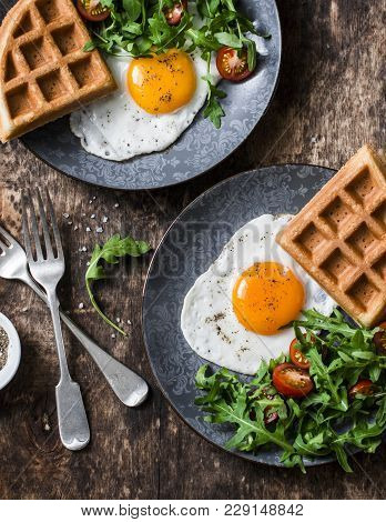 Fried Egg, Arugula Tomato Salad And Savory Whole Grain Waffles - Healthy Breakfast Or Snack On Woode