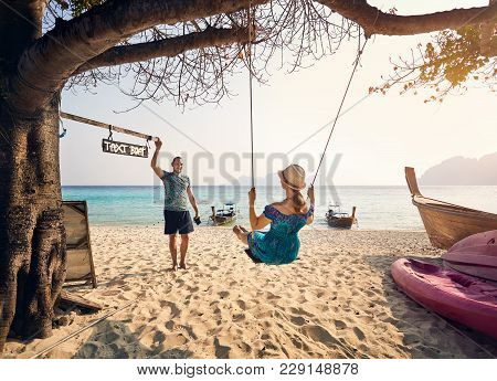 Happy Couple On The Tropical Beach Of Phi Phi Island In Southern Thailand. Travel Magazine Concept.