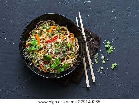 Pad Thai Vegetarian Vegetables Udon Noodles In A Dark Background, Top View. Vegetarian Food In Asian