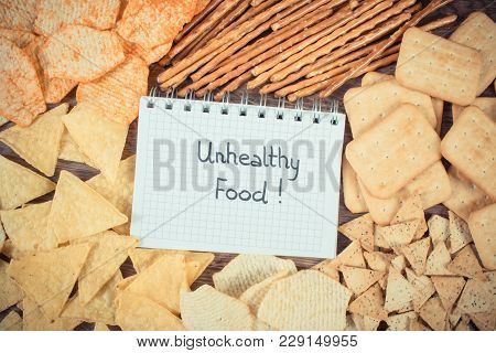 Vintage Photo, Inscription Unhealthy Food In Notebook, Crunchy Potato Crisps, Breadsticks And Cookie