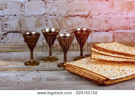 Pesach Passover Symbols Of Great Jewish Holiday. Traditional Matzoh, Matzah Or Matzo And Wine In Vin
