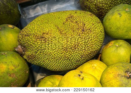 Jackfruit With Green Spiky Skin And Big Stem In Wooden Box