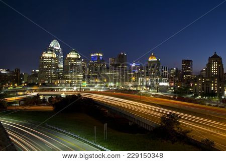 Cincinnati, Ohio - July 30, 2015: View Of The Cincinnati Skyline And I-71 Traffic At Dusk. Cincinnat
