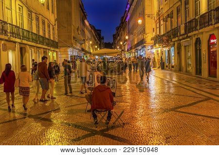 Lisbon, Portugal - September 11, 2017 Street Artist Shoppers Rua Augusta Street Evening Walking Shop
