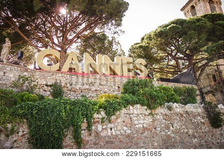 Cannes, France -- May 21, 2017: The Famous Landmark Sign Of Cannes Written In Light Bulbs In The Hei