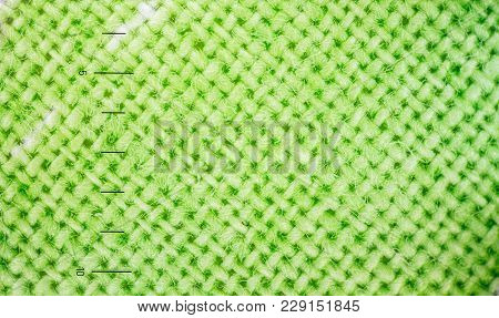 Enlarged Image Of A Cloth Fabric. Fabric Texture Concept For Background Or Wallpaper. Green Colour