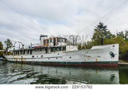 Derelict Motor Yacht On Steamboat Slough In Everett, Washington.  The Slough Is Home To Many Such Ve