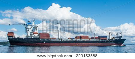 Seattle Bound Freighter Under Clear Sky With Puffy Clouds
