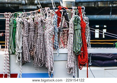 Various Sheets And Mooring Lines On Lifeline Of Sailing Yacht.